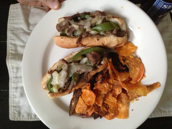 Philly cheesesteaks, bakes sweet potato chips and Evan's thumb holding up the plate to give me better lighting.